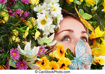 Girl with butterfly and flower on green grass.