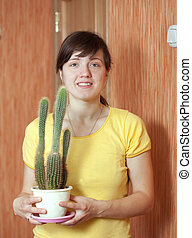 Girl with cactus in the pot