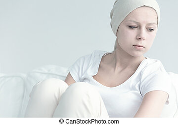 Girl with cancer looking away in resignation