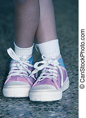 Girl with canvas shoes