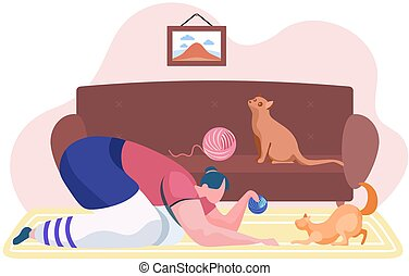 Girl with cat is resting at home. Woman with the ball of thread is playing with her kitten