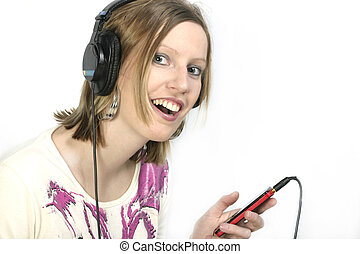 Girl with cell phone and headphones, listens music