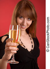 Girl with champagne, focus on glass