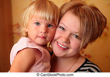 girl with child on hands
