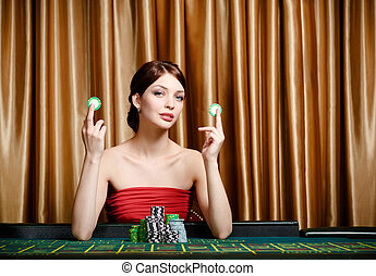 Girl with chips at the casino table