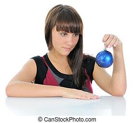 Girl with Christmas balls