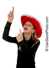 girl with christmas hat is pointing