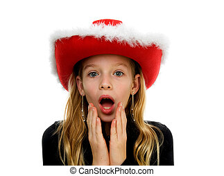 Girl with christmas hat lookes amazed