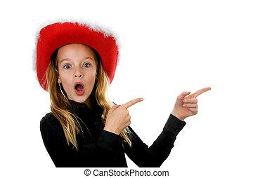 Girl with christmas hat looks amazed