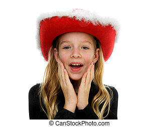 Girl with christmas hat looks surprised