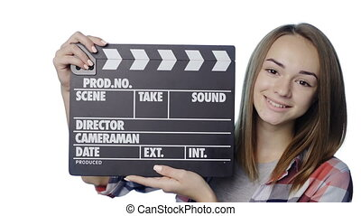 Girl with clapperboard winking - Smiling girl with...