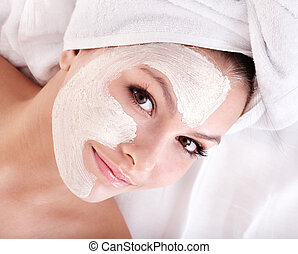 Girl with clay facial mask. - Young woman with clay facial...