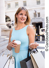 girl with coffee and shopping bags