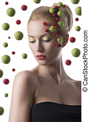 girl with colored spheres on the face