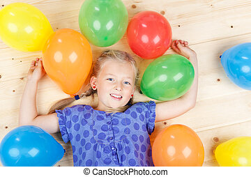 Girl With Colorful Balloons Lying On Floor