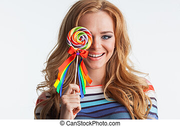 Girl with colorful lollipop