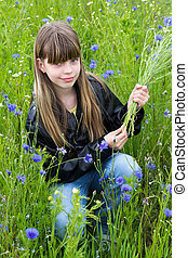 Girl with cornflower