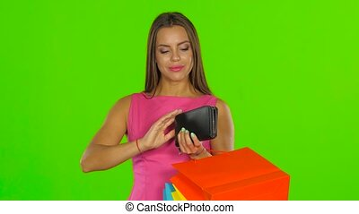 Girl with credit card and shopping bags. Green screen