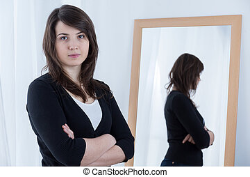 Girl with crossed arms - Image of girl standing with crossed...