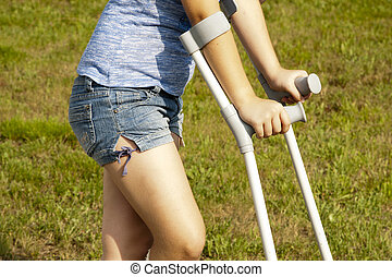 girl with crutches