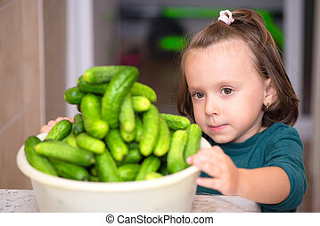 Girl with cucumbers
