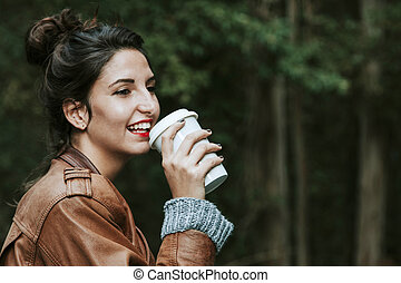girl with cup of coffee on the street, fast food
