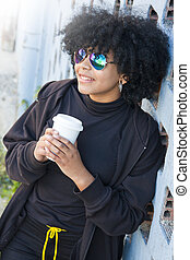 girl with cup of coffee on the street
