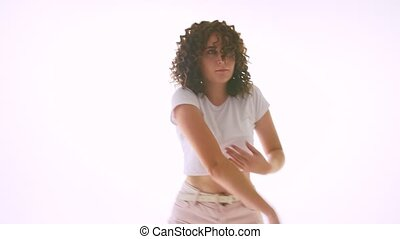 girl in shorts and with curly hair dancing