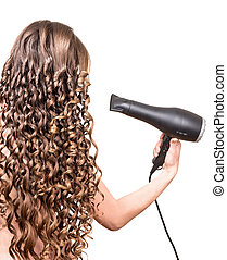 Girl with curly hair holding hairdryer isolated on white background.
