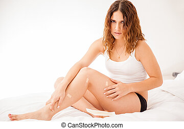Girl with cut legs after shaving