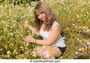 girl with daisies in the summer