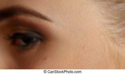 Girl with dark glamour makeup. Closeup