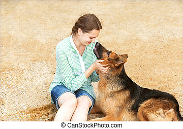 girl with dog happy in the beach