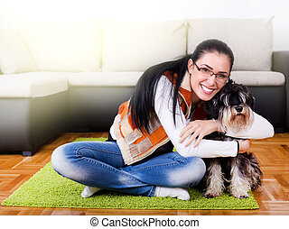 Girl with dog in the room