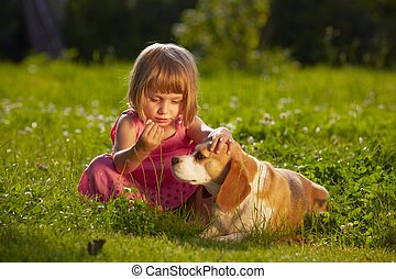 Girl with dog - Little girl with dog in the garden