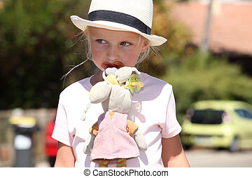 Girl with doll cloth