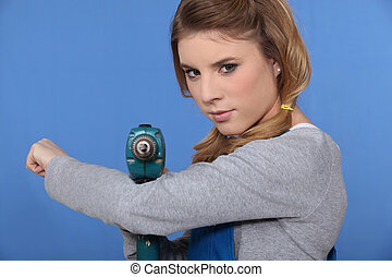 Girl with drill on blue background
