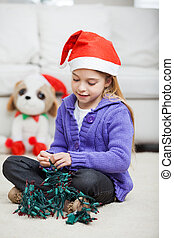 Girl With Fairy Lights During Christmas