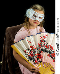 Girl with fan and mask in dress