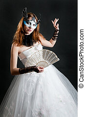 Girl with fan and mask in white dress