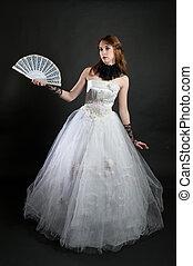 Girl with fan in white dress