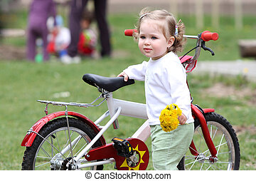 girl with flower and bicycle