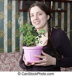 Girl with flower in the pot