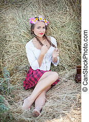 girl with flower wreath outdoors