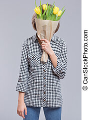 Girl with flowers - Beautiful girl hiding face behind bunch...
