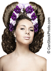 Girl with flowers in a beautiful hairstyle