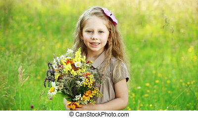 Girl with flowers loking at camera