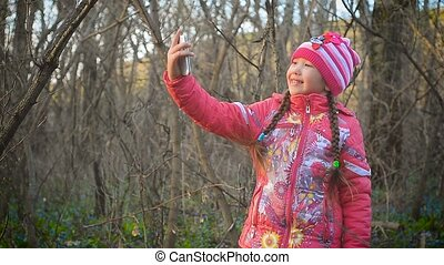 Girl with flowers makes selfie