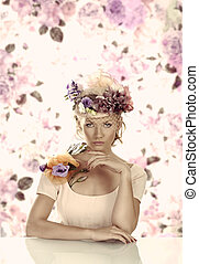 girl with flowers on the hat in front of the camera
