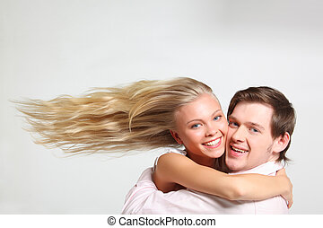 girl with flying hair embraces young man - girl with flying...